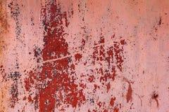 红色绘了与铁锈条纹的金属背景创造性、纹理和背景的 库存图片