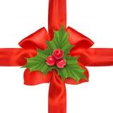 红色缎丝带弓和霍莉莓果小树枝 库存图片
