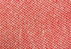 红色编织或被编织的织品纹理样式背景 免版税库存图片