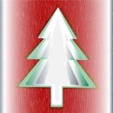 红色背景绿色圣诞树 免版税库存照片