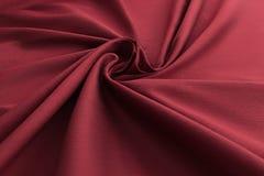 红色背景豪华布料或难看的东西丝绸纹理缎天鹅绒波浪折叠  库存图片