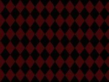红色背景黑色砖的金刚石 免版税库存照片