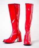 红色膝盖长度乙烯基迪斯科启动 库存图片