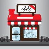 红色自行车商店动画片 图库摄影
