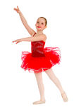 红色芭蕾舞短裙的跳芭蕾舞者孩子 图库摄影