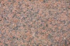 红色花岗岩墙壁作为纹理背景 免版税库存照片