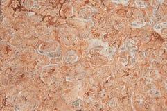 红色花岗岩墙壁背景纹理 免版税库存照片