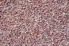 红色花岗岩石渣墙壁  免版税库存照片