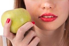 红色苹果绿的嘴唇 库存图片