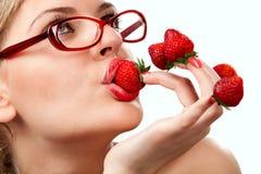 红色草莓妇女 库存照片