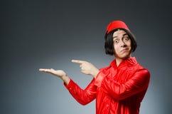 戴红色菲斯帽子的人 免版税库存图片