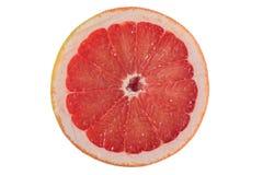 红色葡萄柚被隔绝的切片 免版税图库摄影