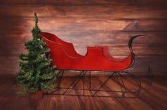 红色葡萄酒圣诞节雪橇数字照片背景  库存图片
