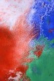 红色蓝绿色油漆混合条纹  免版税库存图片