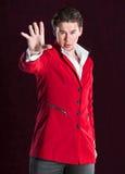 红色衣服的典雅的微笑的年轻英俊的人 免版税图库摄影