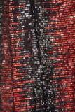 红色衣服饰物之小金属片纺织品 库存照片