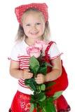 红色衣裳的时髦的女孩 免版税图库摄影