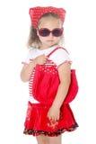 红色衣裳的时髦的女孩 库存图片