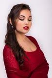 红色衣裳的美丽的女孩 免版税库存照片