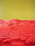 红色被加点的单块玻璃 库存照片