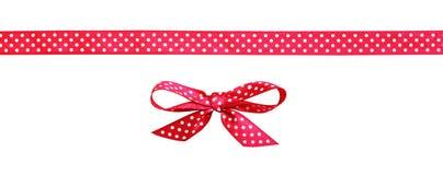 红色被察觉的弓和丝带 免版税库存照片