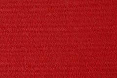 红色被排行的纸纹理或背景 免版税库存图片