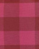 红色被检查的织品 库存图片