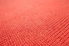 红色被编织的织品纹理 免版税库存图片