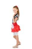 红色裙子的女孩 免版税库存图片