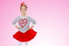红色裙子的小女孩 库存图片