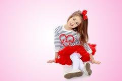 红色裙子的小女孩 免版税图库摄影