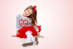 红色裙子的小女孩 图库摄影