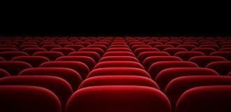 红色观众席或戏院大厅胳膊椅子 库存图片