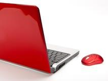 红色计算机鼠标和红色笔记本 免版税库存照片