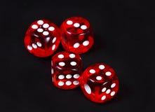 红色赌博切成小方块 库存图片