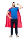 红色超级英雄海角的愉快的人 库存图片