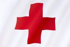红色跨的国际援助的旗子 库存图片