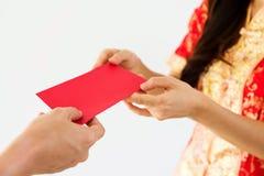 红色金钱包围春节 免版税图库摄影