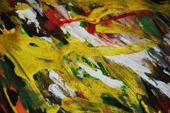 红色金黄橙色绿色闪耀的背景,五颜六色的生动的蜡状的颜色,对比创造性的背景 库存照片