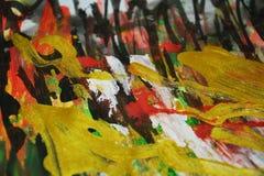 红色金黄橙色闪耀的背景,五颜六色的生动的蜡状的颜色,对比创造性的背景 免版税库存照片