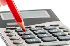 红色铅笔和计算器 免版税库存图片
