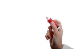 红色铅笔在手边 库存照片