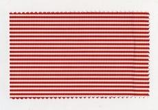 红色镶边织品样品 图库摄影