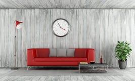 红色长沙发在老木室 皇族释放例证