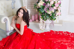 红色长的礼服的妇女 库存照片