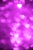洋红色颜色心脏bokeh背景照片 抽象假日,庆祝背景 免版税库存照片