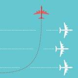 红色飞机改变的方向 库存图片