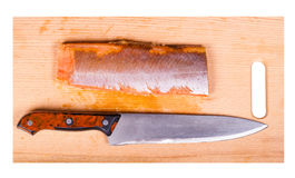 红色鱼片和刀子 图库摄影