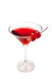红色鸡尾酒用两棵樱桃 查出在白色 免版税库存图片