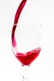 红色鸡尾酒motiom水,在白色背景的香槟 库存照片